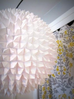Make this lamp shade out of a paper lantern and origami fortune-tellers!
