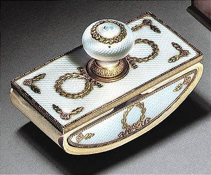 A Faberge silver, gold and translucent oyster enamel desk blotter, Moscow, circa 1900,  enamelled translucent oyster over a guilloche ground, the swivelling upper plate with gold Greek key pattern border, applied with vari-coloured gold ribbin-tied laurel wreaths, marked K.Faberge in Russian with Imperial warrant, 88 standard and 56 standard, scratched inventory number 30299, Length: 8.8 cm., 3 1/2 in.