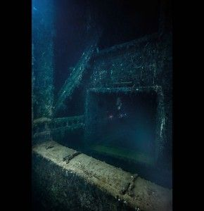 Leaving a hold of the Yamagiri Maru. Truk Lagoon, Micronesia. The wreck lies on its side