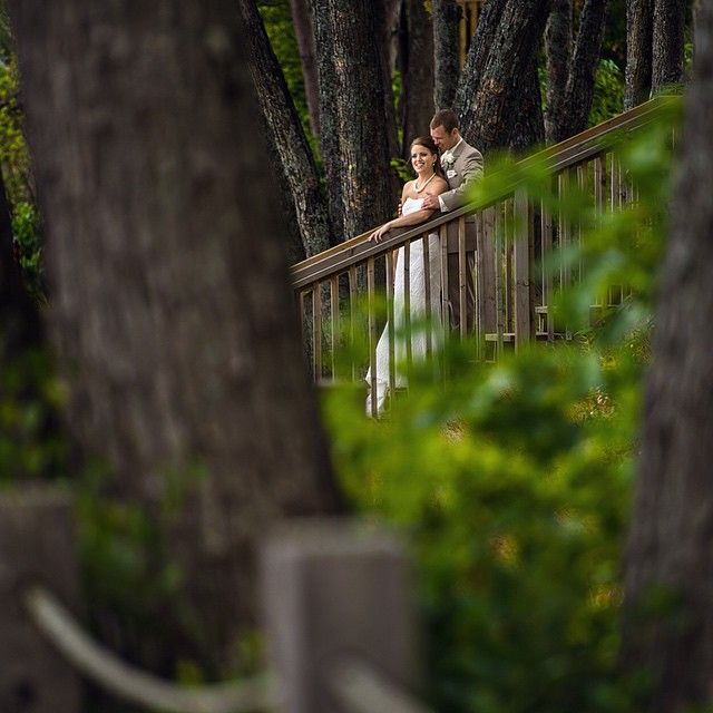 Wedding photos at Deerhurst Resort. Using trees in the foreground to create an intimate couples portrait.   #wedding #weddingromance #muskokawedding #muskoka #deerhurstresort #FindMeAtDeerhurst Deerhurst wedding photography. Muskoka wedding photographer.