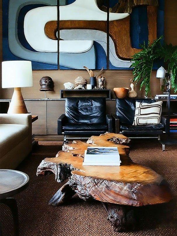 Rústico urbano. Observe como a mesa de tronco + tapete de sisal deram uma pegada rústica à esta sala moderna e urbana. Mistura perfeita para agradar ambos os sexos.