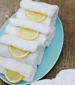 Great idea for a crawfish boil. Leave guests with a memory of the delicious feast -- not the scent. Before the party, dunk a few washcloths or thick paper towels into cold water. Roll and stack them on a tray and place in the fridge. After the meal, serve them with lemon wedges for partygoers to clean their hands.