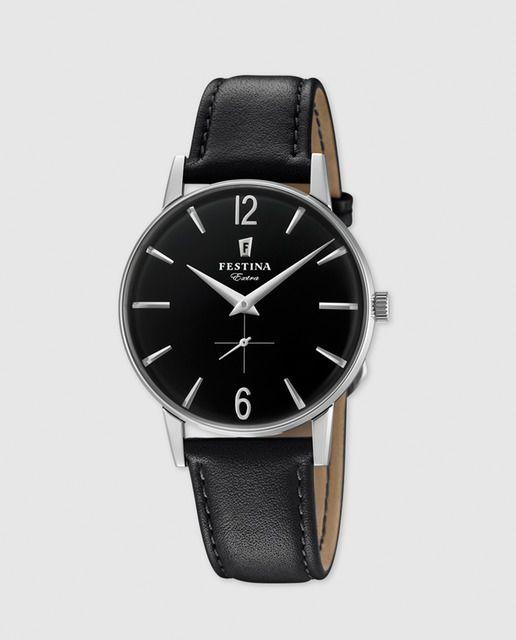 139€ Reloj analógico de cuarzo con caja redonda de acero, esfera negra y correa de piel en color negro.