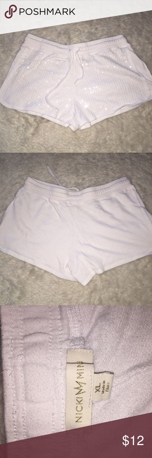 White sequence shorts Cute white short shorts by Nicki Minaji. Adorable, all the sequence is there and looks super cute when worn to work out class! Nicki Minaj Shorts