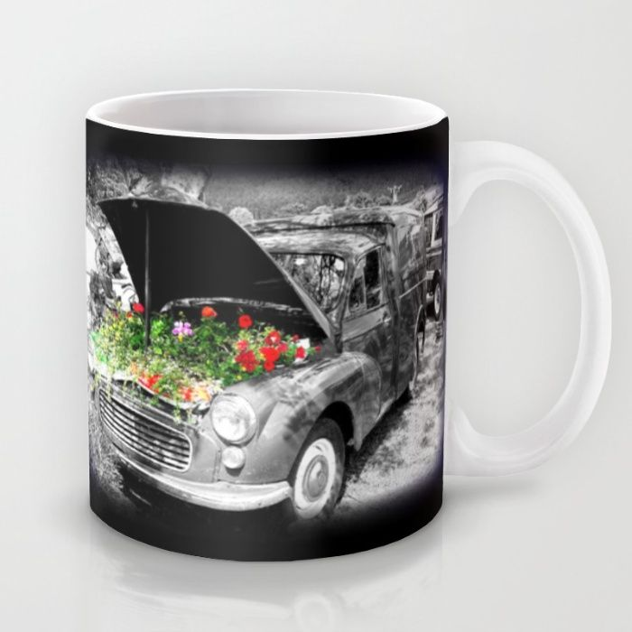 'Minor Florist' Mug. An old Morris Minor car sits in retirement somewhere outside a pub in Ireland. The old engine has been replaced by colourful flowers.  #mugs #cups #old #cars #classic #morrisminor #flowers #vintage #photos #ireland