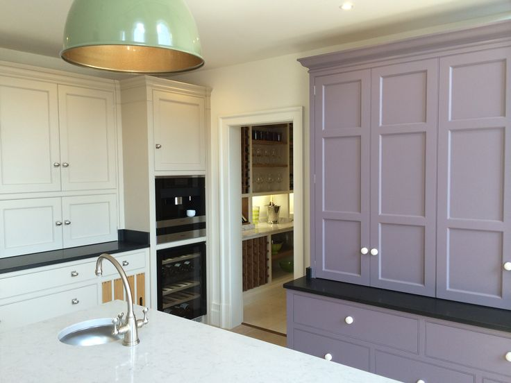 Lilac cabinets provide a hint of colour and add character to this otherwise neutral and traditional kitchen space, featuring Miele appliances #kitchendesign