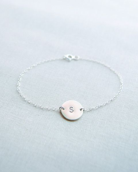 Silver Disk Initial Bracelet by Olive Yew. Petite disk is hand stamped with the letter of your choice.