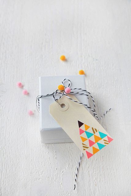 decor8 | cute little package. love the petite pom poms!