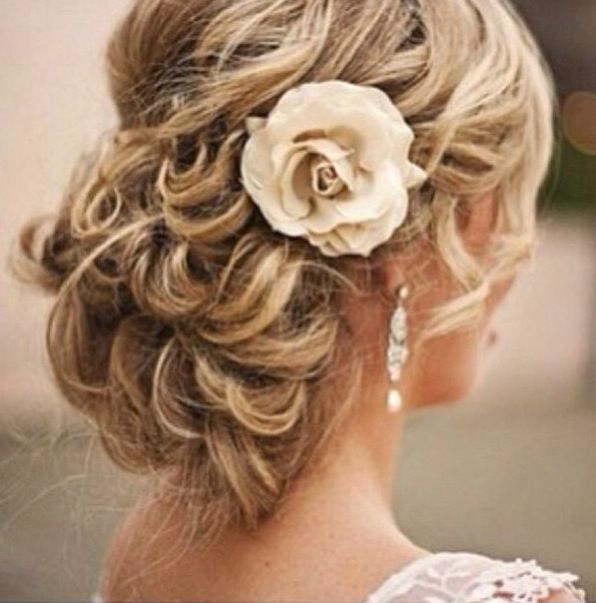 Instead of an up-do, try a low or asymmetrical bun with loose curls.