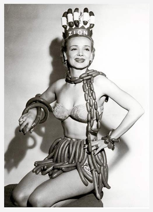 The Sausage Queen, sponsored by the Zion Meat Company, Hot Dog Week, 1955.  What do you suppose she did for the talent competition?