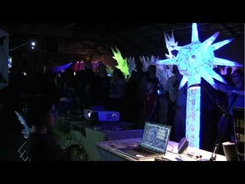 NeuroDisco: Intelligent Dance Music 2.0 - mood and conscious thoughts generate dance music and are visualized on a glowing 7 ft tall neuron. Signal from Emotiv EPOC headset. By Richard Warp, Erica Warp, and Chung-Hay Luk