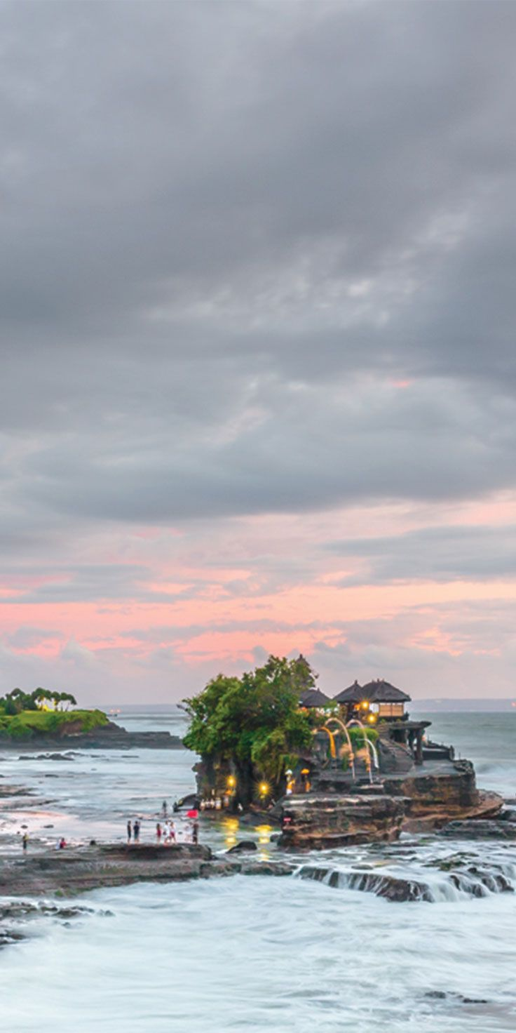 Moody skies over Tanah Lot Temple, Bali - by Jewels Lynch
