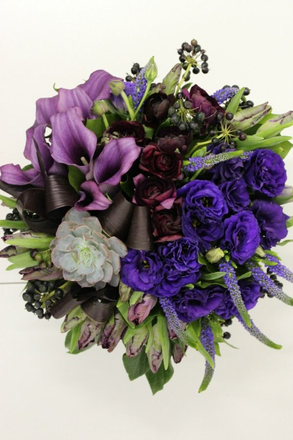 This is one our recent designs using touches of Radiant Orchid in our flower arrangement. Flowers by Blank Slate Events.