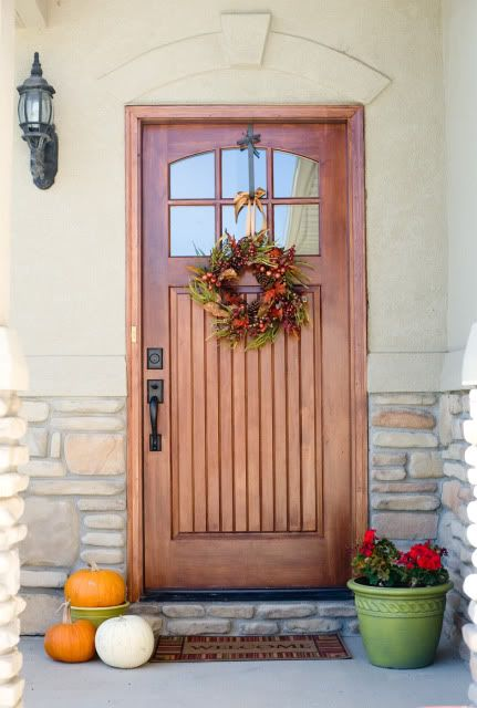 beautiful wooden door and wreath