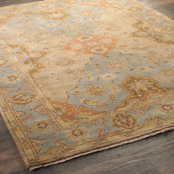 Copper on Sky Blue Oushak Rug Featuring sturdy Oushak construction in premium wool, this classic traditional pattern features a beautiful color pallet of sky blue slate warmed by copper, salmon and cocoa. Select from several size options including a 10' runner. 100% wool