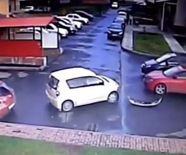 Driver fails at exiting parking lot. A driver takes an incredibly long time trying to exit a parking lot.