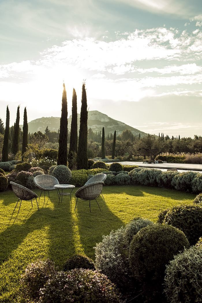 Summer Style! Perfect outdoor lawn and garden with tall Italian cypress trees! Soft gray Wicker chairs and table! So gorgeous and elegant!