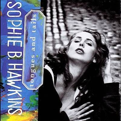 I just used Shazam to discover Damn I Wish I Was Your Lover by Sophie B. Hawkins. http://shz.am/t5090892