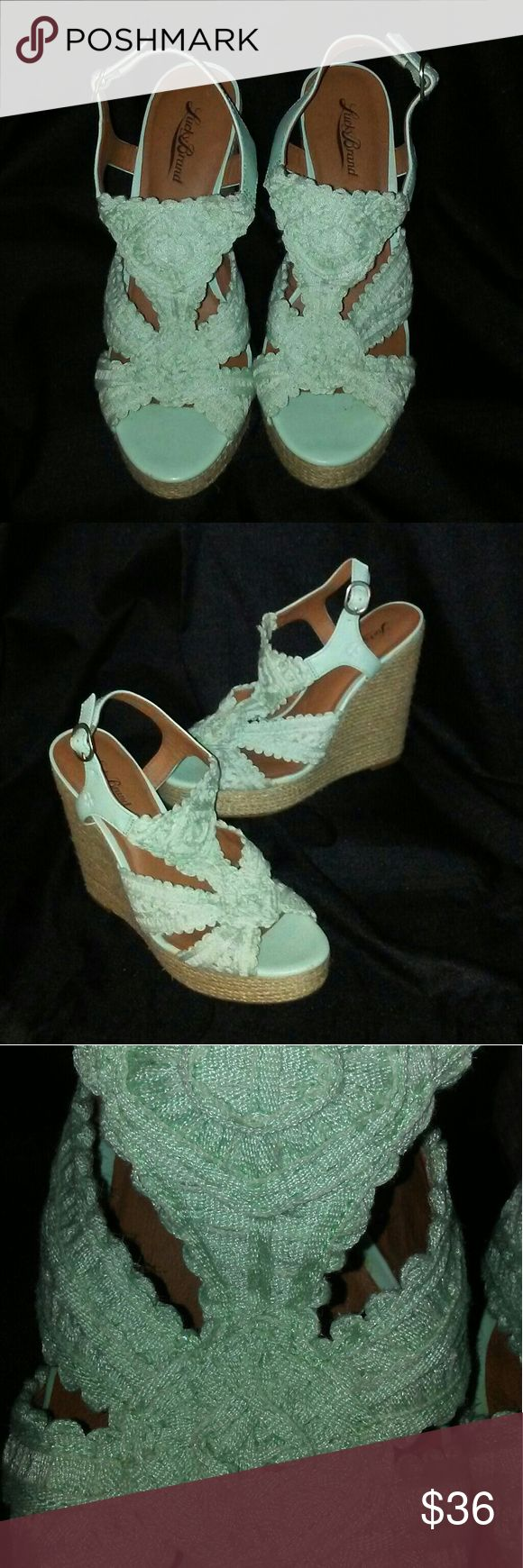 Lucky Brand Teal Wedges Worn once then stored away. Great condition. Very minor scratch as seen in pic6. Only little bit of wear shown on bottom of shoes. No cracking or peeling. No stains on fabric only little fraying but nothing noticeable. Smoke and pet free home. Open to offers. Lucky Brand Shoes Wedges