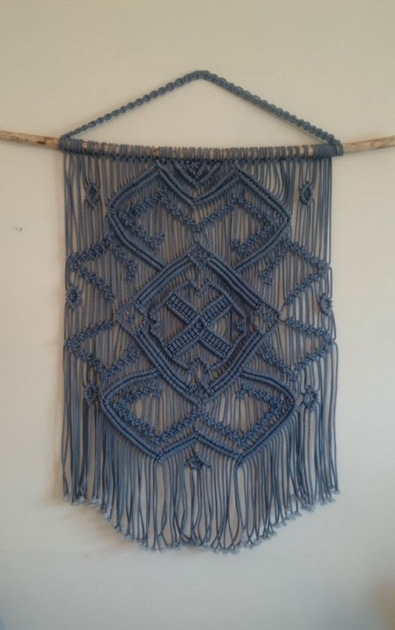 Blue macrame wall hanging on a tree