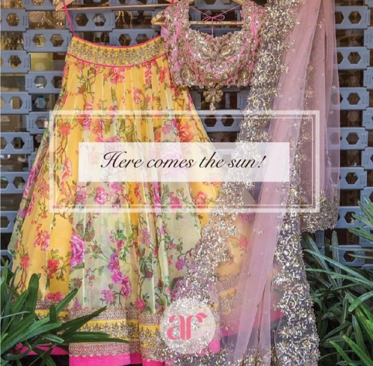 Yellow floral ghagra choli with pink dupatta