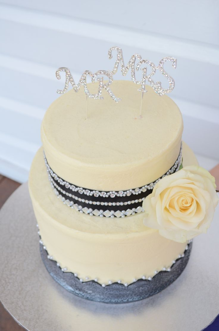 Two tier, double barrel with black fondant detailing