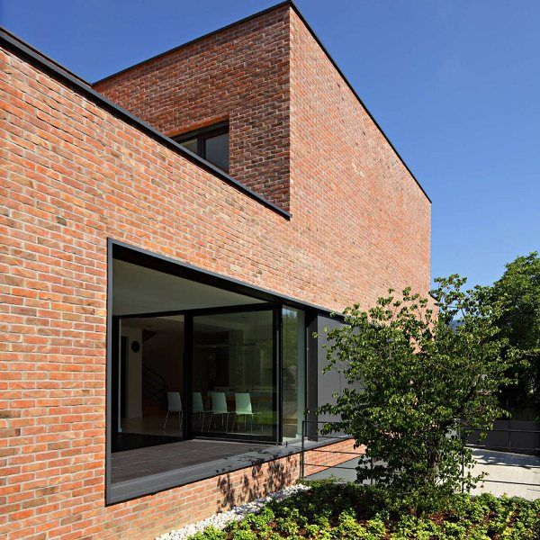 17 mejores ideas sobre fachada de ladrillo rojo en for Casas modernas ladrillo