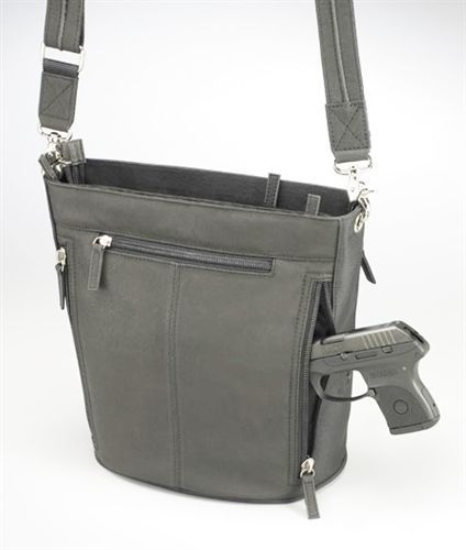 GTM Bucket Tote CCW Holster Purse. Enjoy this  black leather handbag. Fashionable with a lot of functionality. Adjustable and removable SLASH RESISTANT shoulder strap. Full grain tumbled drum dyed leather with microfiber accents. this handbag will get but