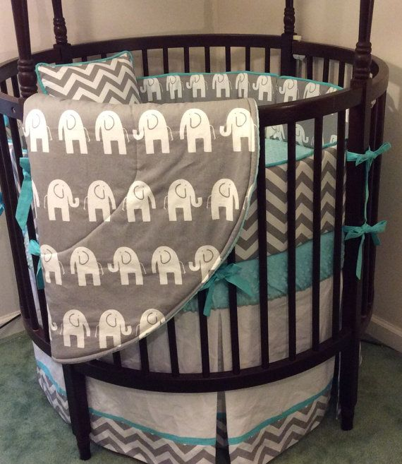 **This is a deposit for half of the total of $415. When the bedding is completed, you will be invoiced for the balance** You will receive the bumper, sheet, skirt and blanket for a round crib. 1 bumper pad made as shown 1 crib skirt as shown 1 fitted crib sheet as shown 1