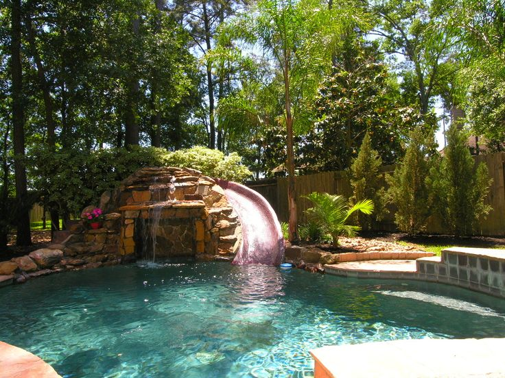 This A Lovely Small Outdoor Pool With Water Slide Backyard Pool Swimming Pool Designs Backyard Pool Landscaping