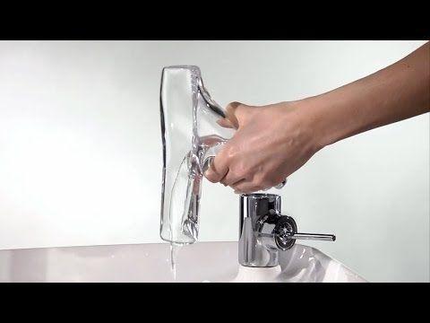 a swirling vortex animates philippe starck's AXOR starck V faucet