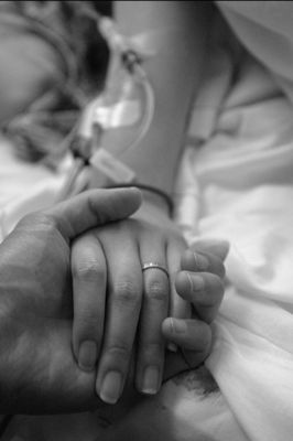 (Open RP. I need someone to be the guy. They are boyfriend and girlfriend. The girl was just in a car accident. She's now a paraplegic. No fandom or powers please) He sits still, holding my hand and rubbing my fingers. I haven't said anything since the accident. We just sit quietly waiting for the nurse to come back.