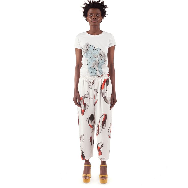 Koi Trousers are a pair of digitally printed mid-waist trousers that feature an elastic band waist and side pockets. Perfect for summer days.