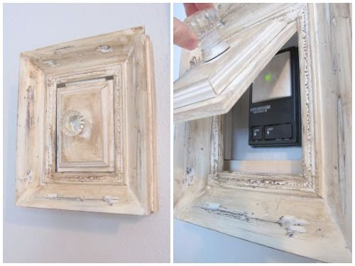 Created a shabby chic cover for your garage door opener using just an old frame, a hinge, scrap wood, and a crystal knob.