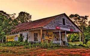 Old country stores. I thought this was a painting, but it is a photo entitled Old Country Store at Lake Bowen by Enterprise NCC-1701 and shared on Flickr.