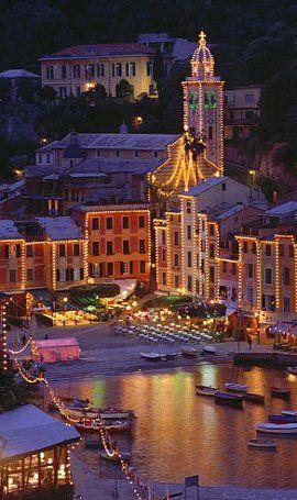 Portofino, the height of Italian chic. The buildings curve round the bay of Portofino like a theatre backdrop