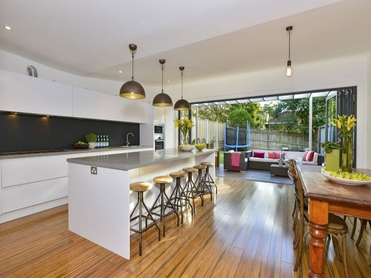 Mosman house. simple kitchen, good use of stackable bi-fold doors opening up the home for outdoor use #kitchen