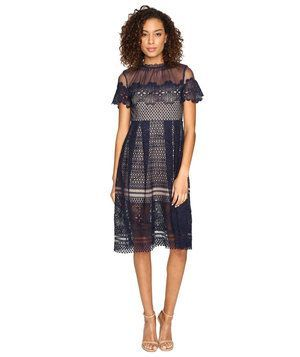 Think beyond the expected metallics—and your trusty LBD, for that matter—and opt for something a little different this year. This intricate navy lace dress is eye-catching in all the right ways (no bling required).