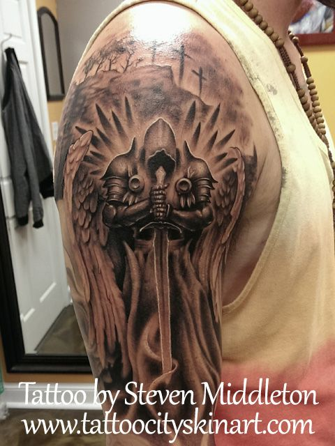 Angel Knight Bicep. Top of black and grey full sleeve tattoo. realistic tattoo by Steven Middleton. Tattoo City Skin Art, Lockport, IL. www.tattoocityskinart.com