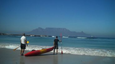 Bloubergstrand, Cape Town, South Africa. Bloubergstand is a great place for windsurfing. You get a great views of the ocean and Table Mountain from Bloubergstrand. #Bloubergstrand #windsurfing #capetown #tablemountain#africa #travel #southafrica #beach #ocean