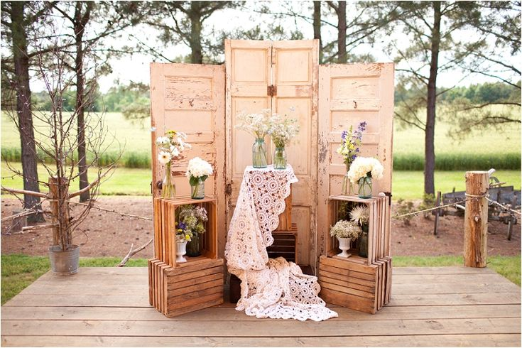 i really like this rustic backdrop. We could even drape the baptism dress where that white lace is.