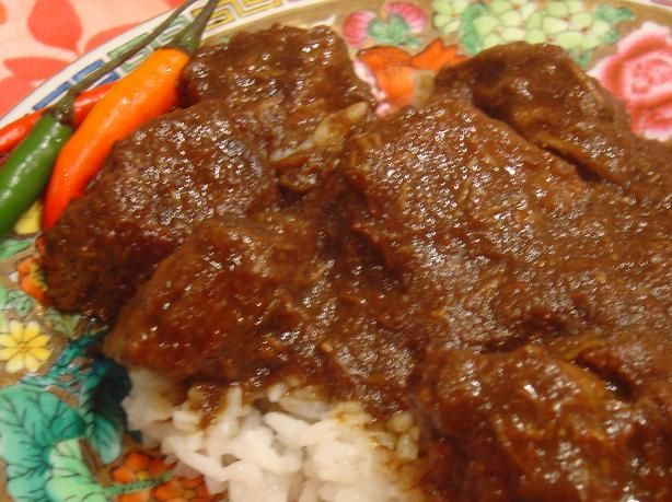 Rendang Padang - Indonesian Beef Curry (Slow Cooker)This is a very close representation to what I have had in restaurants.  But beware because it can be quite spicy depending on the heat of the chiles you use.  The beef should be almost falling apart.  Serve with steamed white rice and Achar.  From Secrets of Slow Cooking.