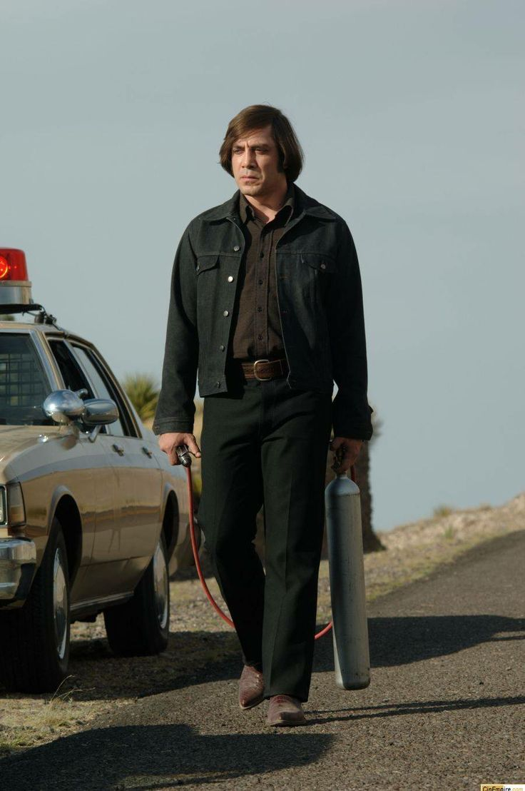 Javier Bardem as Anton Chigurh in the movie adaptation of Cormac McCarthy's excellent novel 'No Country for Old Men'. This guy is cold.
