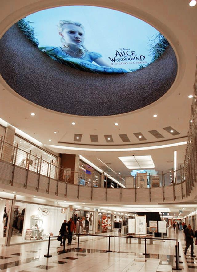 alice in wonderland ceiling ad sticker looking down into mall