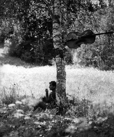 Robert Doisneau ( La Musique) - Maurice Baquet - L'après-midi d'un faune 1957