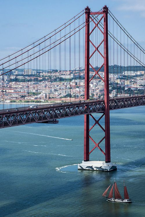 Lisbon, Portugal, very similar to Golden Gate Bridge, supposedly San Francisco's sister city