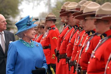 The Crown and Canada.The Queen inspecting the RCMP guard.