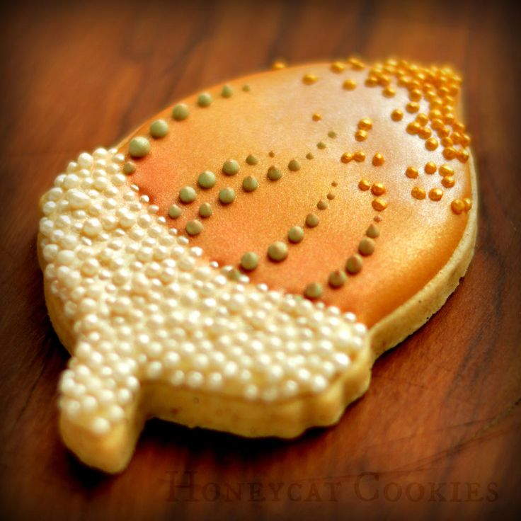 Acorn decorated sugar cookies. Royal icing. Gold, orange, green, yellow.