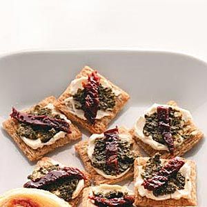 Italian Party Appetizers Recipe    Ingredients  4 ounces cream cheese, softened  48 Triscuits or other crackers  1/4 cup prepared pesto  1/4 cup oil-packed sun-dried tomatoes, patted dry and thinly sliced  Directions  Spread cream cheese on each cracker. Top with pesto and a tomato slice. Serve immediately. Yield: 4 dozen.