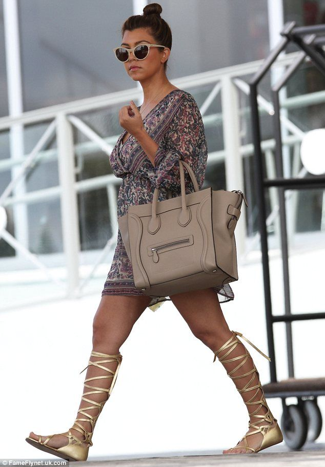 Ready for battle: Kourtney Kardashian stepped out in Miami in gold gladiator sandals on Thursday